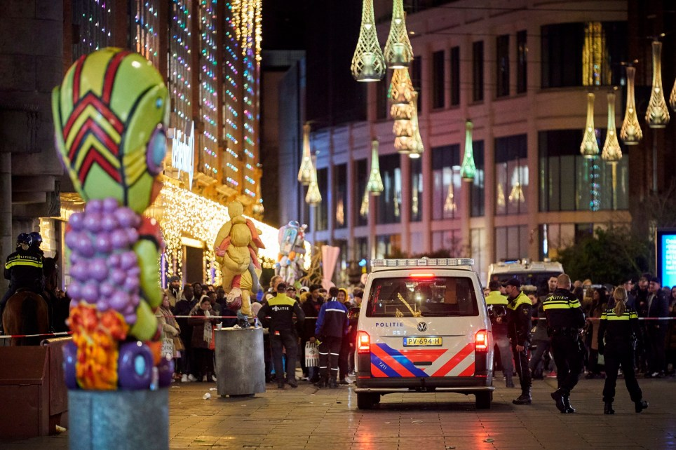 Dutch police block a shopping street after a stabbing incident in the center of The Hague, Netherlands, Friday, Nov. 29, 2019. Dutch police say multiple people have been injured in a stabbing incident in The Hague's main shopping street. (AP Photo/Phil Nijhuis)