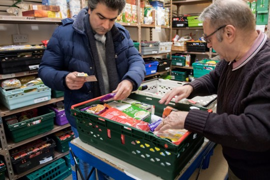 STALYBRIDGE, ENGLAND - JANUARY 28: Foodbank volunteers sort through donations at the warehouse before distributing them to local foodbanks on January 28, 2019 in Stalybridge, England. The Tameside East foodbank is part of a nationwide network supported by The Trussell Trust, a charity working to combat poverty and hunger across the UK. The project was founded by local churches and community groups, working together towards stopping hunger in the area. (Photo by Anthony Devlin/Getty Images)