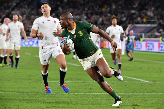 South Africa's wing Makazole Mapimpi scores a try during the Japan 2019 Rugby World Cup final match between England and South Africa at the International Stadium Yokohama in Yokohama on November 2, 2019. (Photo by Kazuhiro NOGI / AFP) (Photo by KAZUHIRO NOGI/AFP via Getty Images)