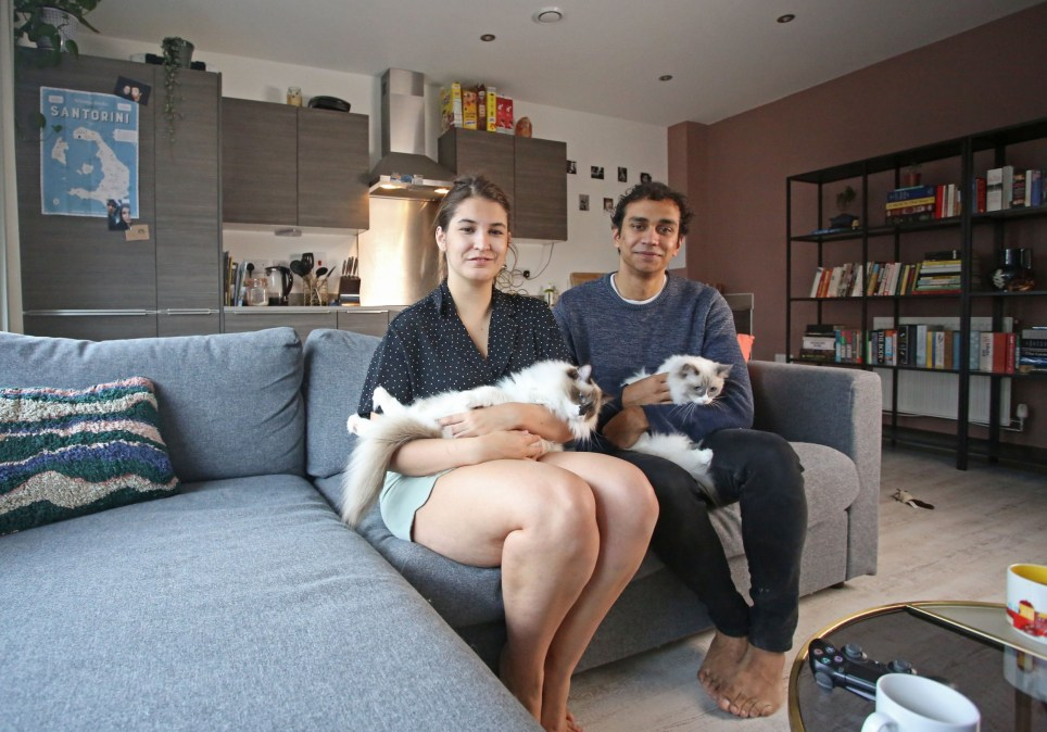Tenants Samantha Van Staden and James Thorpe are pictured with their cat Sprout and Mouse in the combined kitchen and living room of their one bedroom flat in Walthamstow, London, November 2nd, 2019. Samantha and James pay ?1600 a month not including bills. Photo credit: Susannah Ireland