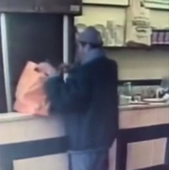 Manze's pie and mash shop catches moment man steals poppy collection