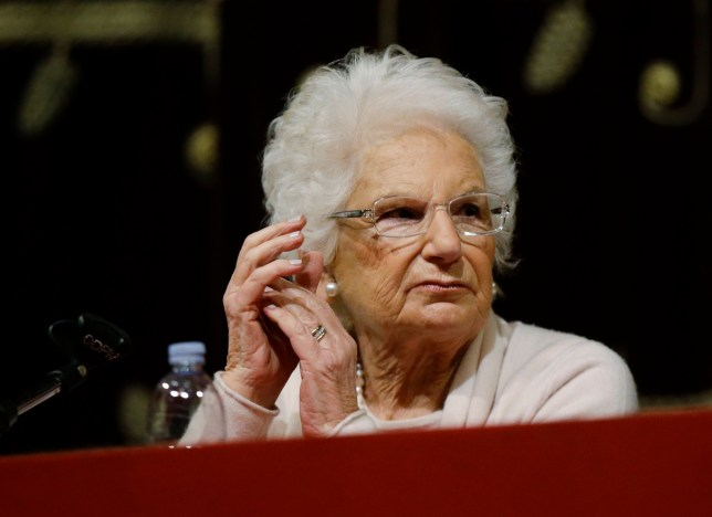 Holocaust survivor Liliana Segre speaks with young students on the occasion of an Holocaust remembrance, at the Arcimboldi theatre in Milan, Italy, Wednesday, Jan. 24, 2018. Segre, a senator for life, unwittingly provoked one of Italy???s most intense confrontations with anti-Semitism since the fall of the Fascist dictatorship when she proposed a motion to create a parliamentary commission against anti-Semitism which the center-right abstained from voting. (AP Photo/Luca Bruno)