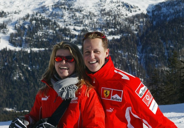 MADONNA DI CAMPIGLIO, ITALY: German Formula 1 driver Michael Schumacher poses with his wife Corinna, in the winter resort of Madonna di Campiglio, in the Dolomites area, Northern Italy, 11 January 2005. Schumacher takes part in the traditionnal Ferrari winter meeting with the press. AFP PHOTO / Press Ferrari (Photo credit should read STR/AFP via Getty Images)