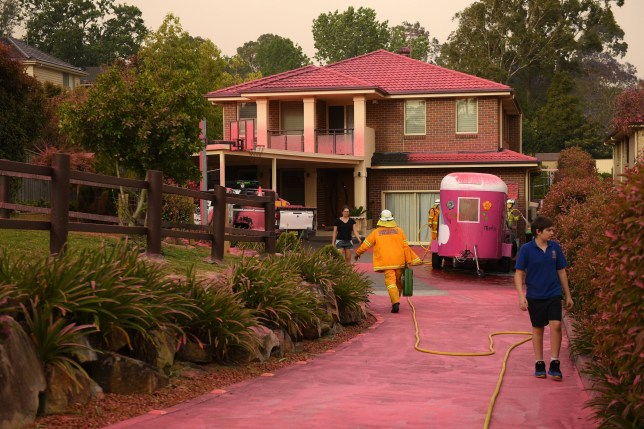 epa07990082 Chemical fire retardant sits on houses after being dropped by aircraft in South Turramurra, near Sydney, New South Wales, Australia, 12 November 2019. At least 60 fires are burning across New South Wales, with a fire front of approximately 1,000 kilometers. According to media reports, 200 properties in New South Wales and Queensland have been destroyed since 08 November. EPA/DAN HIMBRECHTS AUSTRALIA AND NEW ZEALAND OUT