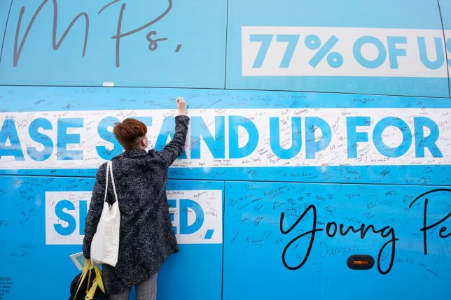 Students at Liverpool's Hope University sign the Our Future, Our Choice, battle bus as activists from the youth movement for a People???s Vote tour the North West on February 11, 2019 in Liverpool, England. Activists from Our Future, Our Choice, a youth movement for a People???s Vote, is touring areas in Manchester, Liverpool, Bolton and Altrincham calling for renewed Brexit referendum. (Photo by Christopher Furlong/Getty Images)
