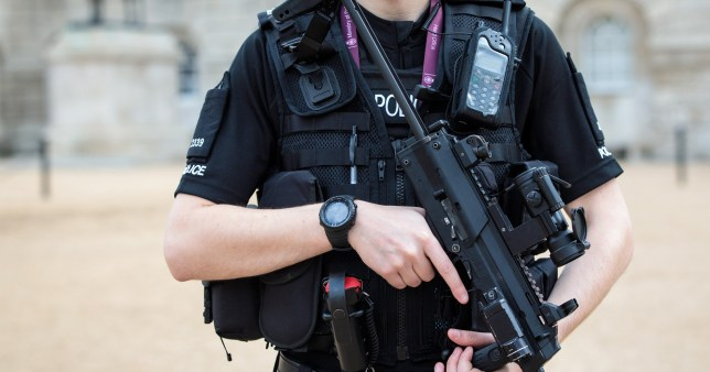 LONDON, ENGLAND - SEPTEMBER 16: An armed police officer patrols in Horse Guards Parade on September 16, 2017 in London, England. An 18-year-old man has been arrested in Dover in connection with yesterday's terror attack on Parsons Green station in which 30 people were injured. The UK terror threat level has been raised to 'critical'. (Photo by Jack Taylor/Getty Images)