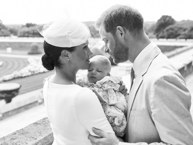 "TOPSHOT - This official handout Christening photograph released by the Duke and Duchess of Sussex shows Britain's Prince Harry, Duke of Sussex (R), and his wife Meghan, Duchess of Sussex holding their baby son, Archie Harrison Mountbatten-Windsor at Windsor Castle with the Rose Garden in the background, west of London on July 6, 2019. - Prince Harry and his wife Meghan had their baby son Archie christened on Saturday at a private ceremony. (Photo by Chris ALLERTON / SUSSEXROYAL / AFP) / XGTY / RESTRICTED TO EDITORIAL USE - MANDATORY CREDIT ""AFP PHOTO / SUSSEXROYAL / CHRIS ALLERTON"" - NO MARKETING NO ADVERTISING CAMPAIGNS - NO COMMERCIAL USE - NO THIRD PARTY SALES - RESTRICTED TO SUBSCRIPTION USE - NO CROPPING OR MODIFICATION - NOT FOR USE AFTER DECEMBER 31, 2019 - DISTRIBUTED AS A SERVICE TO CLIENTS / (Photo credit should read CHRIS ALLERTON/AFP via Getty Images)"