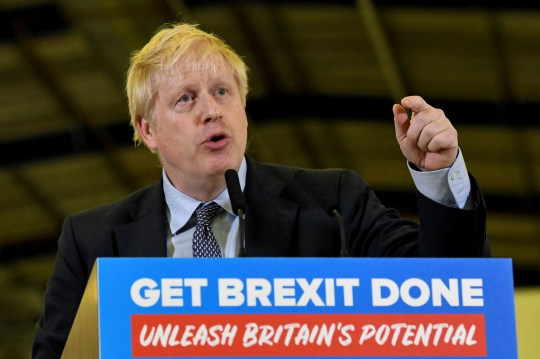 Britain's Prime Minister Boris Johnson delivers a speech during his Conservative party general election campaign visit to the London Electric Vehicle Company (LEVC) in Coventry, central England on November 13, 2019. - Britain goes to the polls on December 12 to vote in a pre-Christmas general election. (Photo by Ben STANSALL / AFP) (Photo by BEN STANSALL/AFP via Getty Images)