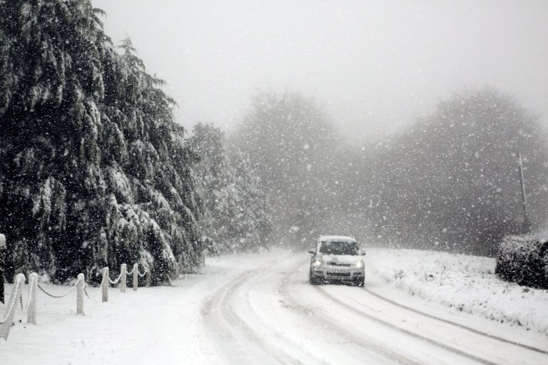 Heavy snow makes roads on Exmoor Impassable on Thursday - A vehicle moves slowly through heavy snow on the B3224 at Raleigh's Crossover the top of Exmoor this morning. November 14, 2019.