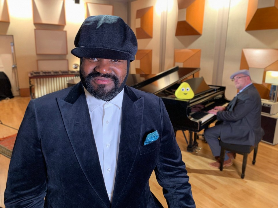 WARNING: Embargoed for publication until 00:00:01 on 15/11/2019 - Programme Name: CBeebies Bedtime Stories - TX: 22/11/2019 - Episode: Bedtime Stories - Gregory Porter (No. n/a) - Picture Shows: ***Embargoed until 15/11/2019 00:00:01*** Gregory sings Moon River, the classic ballad from Breakfast at Tiffany???s, accompanied by Chip Crawford on the piano. Moon River is composed by Henry Mancini with lyrics by Johnny Mercer and illustrations are by Tim Hopgood. Chip Crawford, Gregory Porter - (C) BBC - Photographer: N/A
