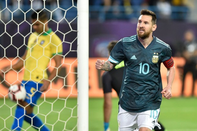 Argentina's Lionel Messi celebrates after scoring his side's opening goal against Brazil