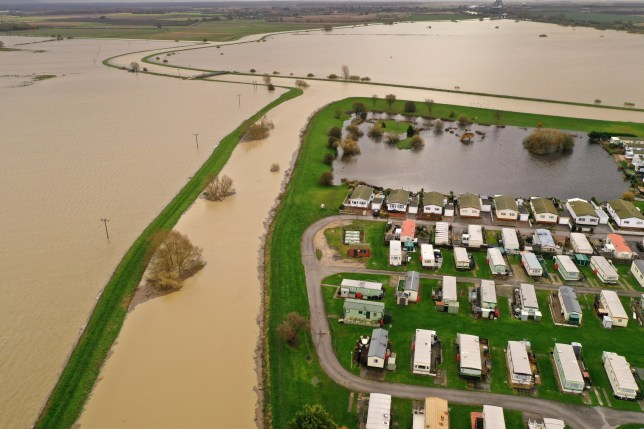 LINCOLN, ENGLAND - NOVEMBER 15: Fields are completely flooded at Bardney, near Lincoln is marooned by floodwater after the Barlings Eau broke its banks on November 15, 2019 in Lincoln, England. Over 1,500 acres of land between six and 10 feet deep, that surrounds the farm and the local area which has been flooded after this weeks torrential rain causing floods across the UK. (Photo by Christopher Furlong/Getty Images)