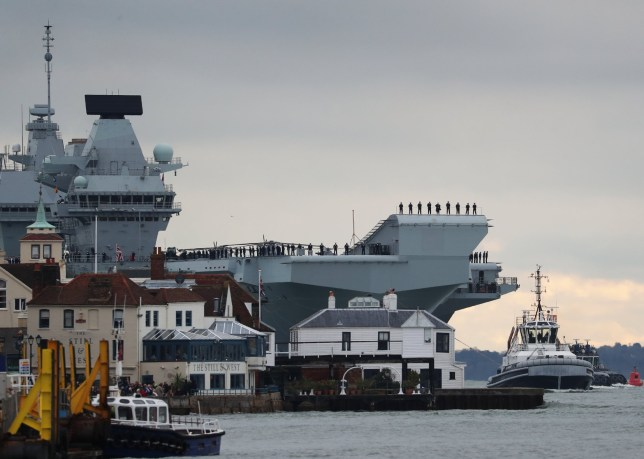 The aircraft carrier HMS Prince of Wales arrives at Portsmouth Naval Base. PA Photo. Issue date: Saturday November 16, 2019. The ??3.1 billion warship left Rosyth dockyard in Scotland, where it was built, in September before undergoing eight weeks of sea trials. Photo credit should read: Steve Parsons/PA Wire