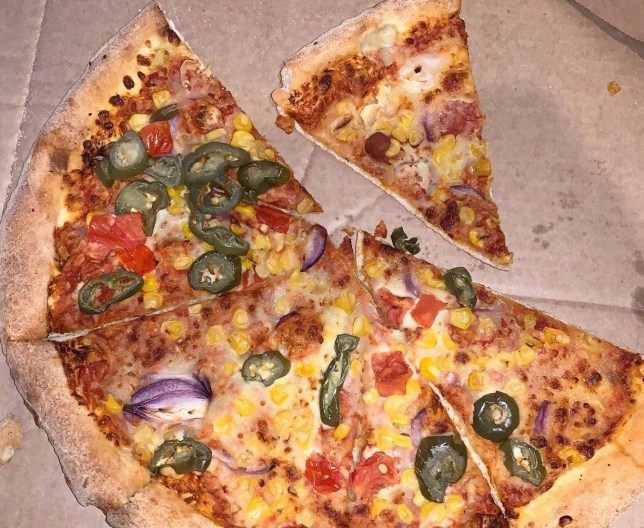 """A Muslim family said they felt ?sick and violated? after being delivered this PORK sausage pizza instead of the vegetarian one they had ordered. See SWNS story SWPLpizza. The Khan family ordered a vegetarian supreme online from Domino's but were horrified when they began ticking into their takeaway. Dad Sami Khan had already eaten a slice when he saw that the ?funny taste? was in fact pork which is against their religion to eat. Domino's have apologised for what they described as an """"innocent mistake""""."""