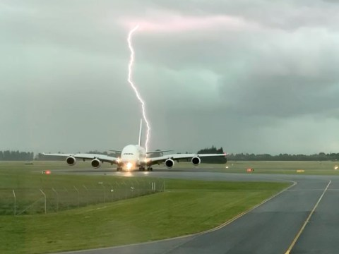 Moment lightning bolt almost hits passenger plane coming to land