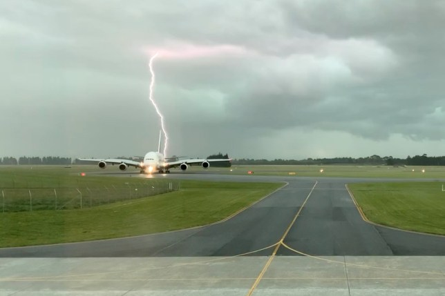 A lightning strikes near an Emirates A380 plane at Christchurch Airport, New Zealand November 20, 2019 in this still image obtained from a social media video. GCH Aviation/via REUTERS THIS IMAGE HAS BEEN SUPPLIED BY A THIRD PARTY. MANDATORY CREDIT. NO RESALES. NO ARCHIVES.
