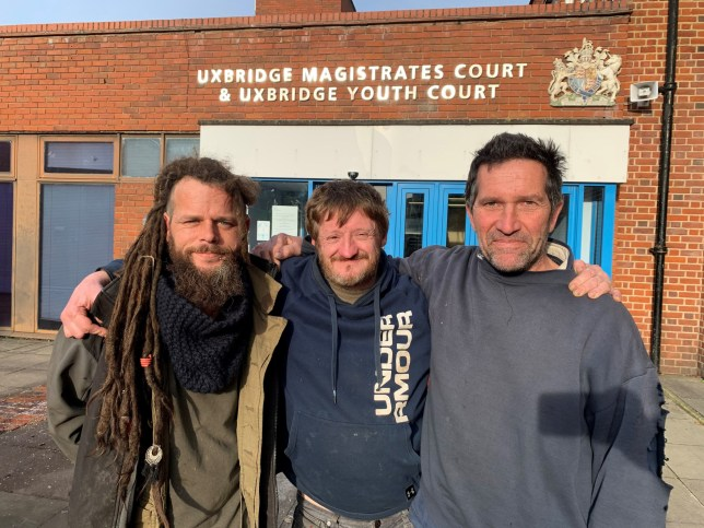 Mark Keir (right), Green Party candidate standing against Boris Johnson in the upcoming General Election, outside Uxbridge Magistrates' Court, with Iain Oliver (left) and Scott Breen, where he denied obstruction of a highway during a protest against HS2. PA Photo. Picture date: Wednesday November 20, 2019. Keir is accused of stopping multiple lorries from accessing the site by laying down in the road by an entrance to the construction site in Harvil Road, Uxbridge with Breen. See PA story COURTS Green. Photo credit should read: Jess Glass/PA Wire