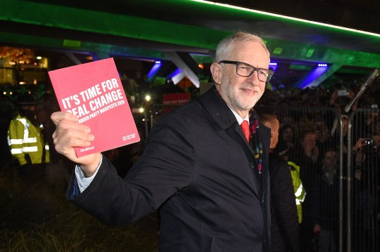Britain's Labour Party leader Jeremy Corbyn holds a copy of the party's manifesto as he arrives to attend the BBC Question Time 'Leaders Special' television show in Sheffield, northern England on November 22, 2019, that will air tonight and will feature the leaders of Britain's four main political parties. - Britain will go to the polls on December 12, 2019 to vote in a pre-Christmas general election. (Photo by Oli SCARFF / AFP) (Photo by OLI SCARFF/AFP via Getty Images)