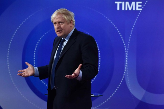 "A handout picture taken and released by the BBC on November 22, 2019, shows Britain's Prime Minister Boris Johnson participating on the BBC's Question Time 'Leaders Special' television show, from Sheffield, northern England, that is set to feature the leaders of Britain's four main political parties. - Britain will go to the polls on December 12, 2019 to vote in a pre-Christmas general election. (Photo by JEFF OVERS / various sources / AFP) / RESTRICTED TO EDITORIAL USE - MANDATORY CREDIT "" AFP PHOTO / JEFF OVERS-BBC "" - NO MARKETING NO ADVERTISING CAMPAIGNS - DISTRIBUTED AS A SERVICE TO CLIENTS TO REPORT ON THE BBC PROGRAMME OR EVENT SPECIFIED IN THE CAPTION - NO ARCHIVE - NO USE AFTER **DECEMBER 12, 2019** / (Photo by JEFF OVERS/AFP via Getty Images)"