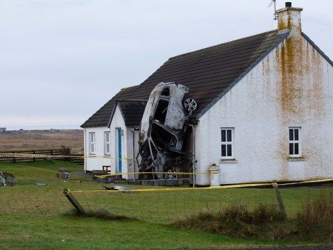 Three seriously injured after car crashes into house and sets on fire