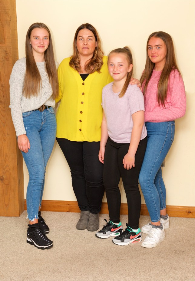 Tara Huck with her daughters, ( L- R) Katie 13yrs, Tara, molly 10 yrs & emily 15 yrs. Three members of Tara Hucks family have died of breast cancer - her mother, her aunt (her mother's sister) and her grandmother (her mother's mum). To stop Tara getting the disease, she's had a double mastectomy. But the unforeseen consequence of this is that her children will no longer have a first degree relative with the disease so won't be eligible for surgery/extra checks. What's more, a new test which could identify the genetic fault which is causing the disease in their family is being delayed being introduced on the NHS. see Rachel Ellis copy. ?? WARREN SMITH 2019 GOODHEALTH.