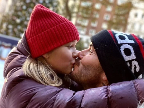 David Beckham kisses Harper on the lips as they get into festive spirit during daddy-daughter date