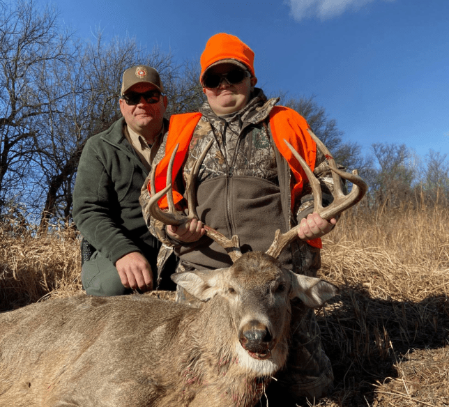 Photo of Braden Mielke, Marshall Reigh and the buck Braden bagged