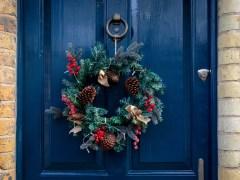 Why do we hang Christmas wreaths?