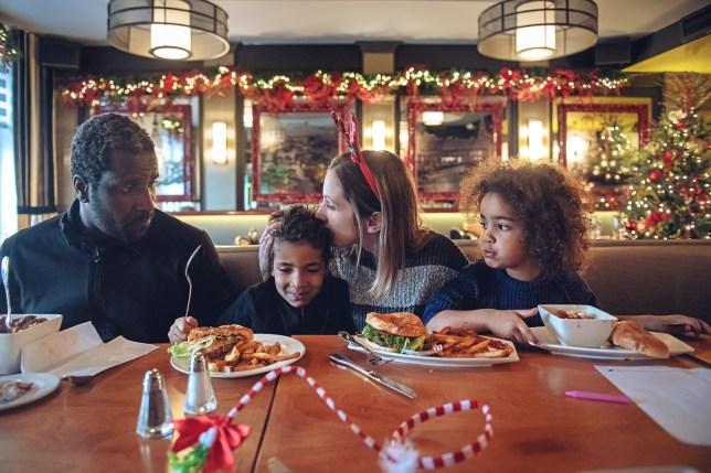 family eating Christmas dinner in a restaurant