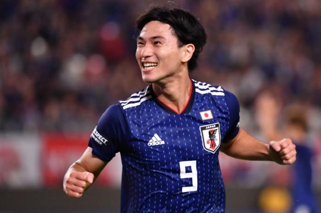 Japan's Takumi Minamino celebrates scoring against Paraguay