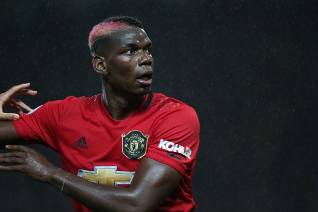 Paul Pogba looks on while playing for Manchester United
