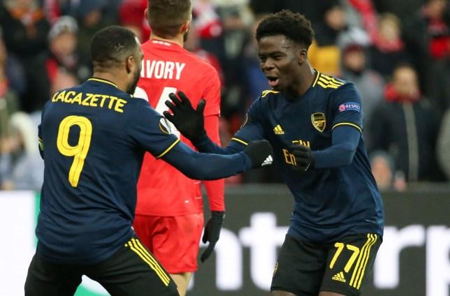 Bukayo Saka of Arsenal celebrates his goal with Alexandre Lacazette