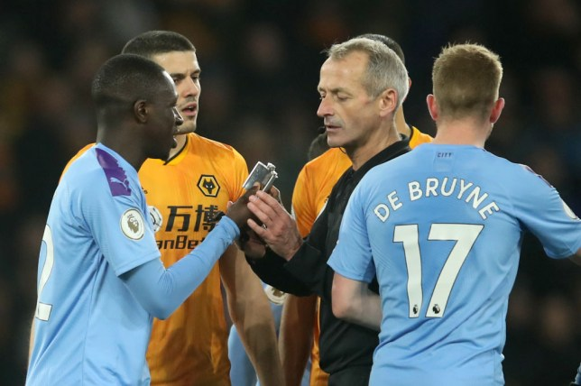 Benjamin Mendy showed referee Martin Atkinson the hip flask thrown onto the Molineux pitch