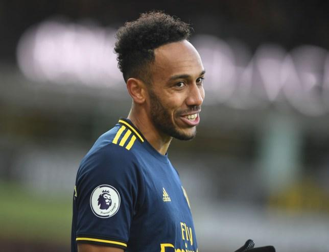 Pierre-Emerick Aubameyang smiles as he plays for Arsenal