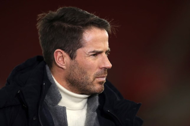 Jamie Redknapp looks on while working as a pundit