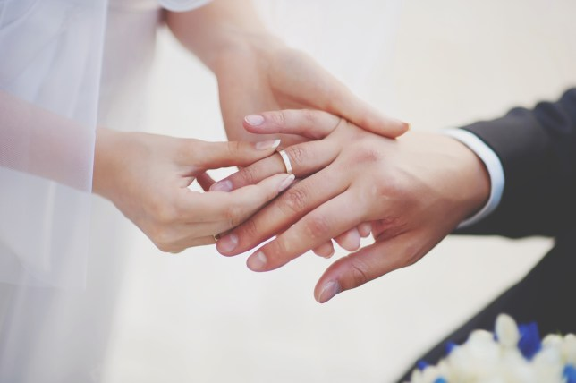 Couple exchanging rings at a wedding