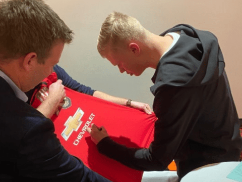 Erling Haaland pictured signing Manchester United shirt amid transfer speculation