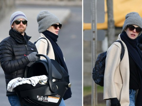 Anne Hathaway and husband seen with baby carrier sparking rumours she's given birth to second child