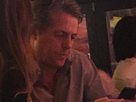 Hugh Grant looks unimpressed as he checks phone amid exit poll announcement