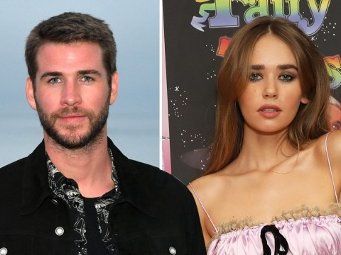 Liam Hemsworth looks smitten with new girlfriend Gabriella Brooks as pair kiss on the beach