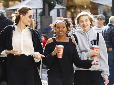 Angelina Jolie gets in last-minute Christmas shopping with Shiloh and Zahara as Brad Pitt 'spends time with children' over holidays