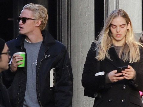 Cody Simpson goes for a stroll with Playboy model after denying cheating on girlfriend Miley Cyrus