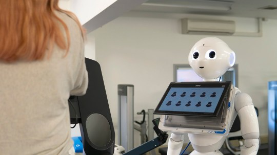 Undated handout photo issued by the University of the West of England, Bristol, of a robot personal trainer that scientists have developed to coach runners through an exercise programme on the treadmill. PA Photo. Issue date: Friday November 29, 2019. Humanoid robot Pepper can tell jokes, show sympathy, lean in towards the runner and change eye colour to express different emotions. See PA story SCIENCE Coach. Photo credit should read: UWE Bristol/PA Wire NOTE TO EDITORS: This handout photo may only be used in for editorial reporting purposes for the contemporaneous illustration of events, things or the people in the image or facts mentioned in the caption. Reuse of the picture may require further permission from the copyright holder.