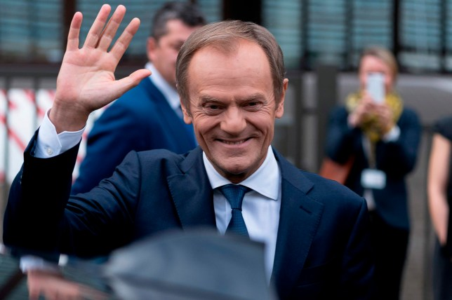 Outgoing European Council President Donald Tusk waves as he leaves the European Council headquarters in Brussels on November 29, 2019, after the handover ceremony between Tusk and successor Charles Michel. (Photo by Kenzo TRIBOUILLARD / AFP) (Photo by KENZO TRIBOUILLARD/AFP via Getty Images)
