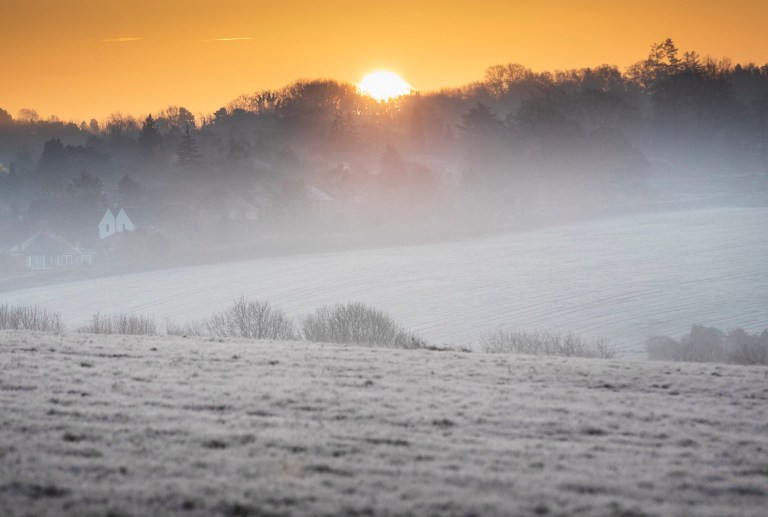 ? Licensed to London News Pictures. 02/12/2019. Epsom, UK. The sun rises over a frozen Epsom Downs. A cold start for some parts of the south with temperatures just below freezing at dawn. Photo credit: Peter Macdiarmid/LNP
