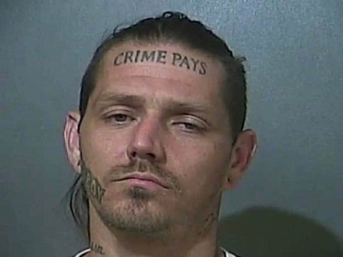 Police hunt man with 'crime pays' tattooed across his forehead