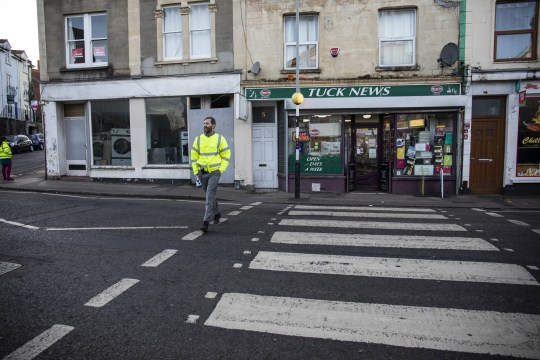 Teachers from Cotham School set up a perimiter around Cotham Road South and prevent students from entering businesses such as Chilli Bellies. Bristol. 2 December 2019. A takeaway owner called the police after claims that two teachers were acting like BOUNCERS outside his shop - and giving detentions to any who refused to leave. See SWNS story SWBRtakeaway. Neil D'Souza, owner of Chilli Bellies in Bristol, says he has seen a massive drop in business since staff from Cotham School started patrolling the streets. The school has a policy of policing nearby roads after the end of the day at 2:45pm - and has banned students from entering various businesses before 3:15pm. Officers were called by Mr D'Souza last week when staff allegedly blocked the entrance to his shop and stepped in to boot pupils out. The school has denied teachers entered the premises at all and insisted teachers were simply making sure pupils got home safely.