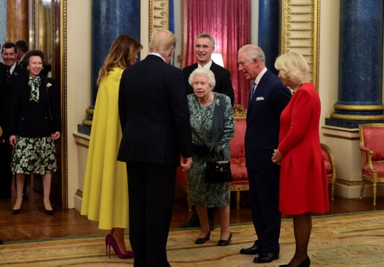 U.S. President Donald Trump with his wife, first lady Melania Trump are seen together with Britain's Prince Charles and Camilla, Duchess of Cornwall during a reception at Buckingham Palace to mark 70 years of the NATO Alliance, hosted by Britain's Queen Elizabeth, in London, Britain, December 3, 2019. Geoff Pugh/Pool via REUTERS