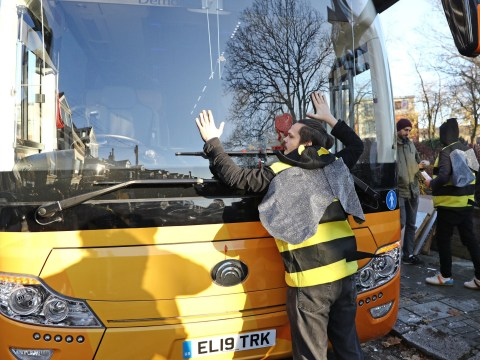 XR protesters dressed as bees glue themselves to electric Lib Dem battle bus