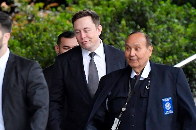 Tesla CEO Elon Musk, second from right, arrives at U.S. District Court Wednesday, Dec. 4, 2019, in Los Angeles. Musk is going on trial for his troublesome tweets in a case pitting the billionaire against a British diver he allegedly dubbed a pedophile. (AP Photo/Mark J. Terrill)